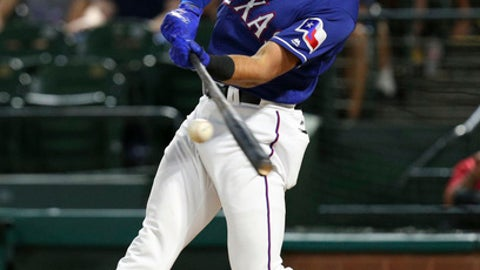FILE - in this Sept. 25, 2017, file photo, Texas Rangers' Joey Gallo connects for a solo home run in the second inning of a baseball game against the Houston Astros in Arlington, Texas. Gallo, who hit 41 homers playing three different positions last season, could get the chance to be the team's primary first baseman.  (AP Photo/Richard W. Rodriguez, File)