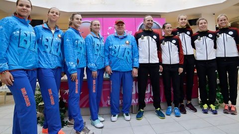Members of Germany Fed Cup team, right, and Belarus Fed Cup team pose for photo after drawing ceremony in Minsk, Friday, Feb. 9, 2018. The Fed Cup World Group first round matches between Belarus and Germany will take place Feb. 10 - 11, 2018. (AP Photo/Sergei Grits)