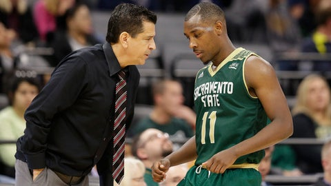 FILE -  In this Nov. 21, 2017, file photo, Sacramento State guard Kevin Hicks talks with head coach Brian Katz during the second half of an NCAA college basketball game against the University of California, Davis, in Sacramento, Calif. Sacramento State appeared to have the type of team that could break the school's NCAA Tournament drought in 2015-16. When senior point guard Cody Demps went down with an injury, those hopes disappeared in a hurry.  (AP Photo/Rich Pedroncelli,file )
