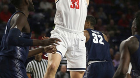FILE - In this Nov. 25, 2017, file photo, Richmond's Grant Golden lines up a shot against Georgetown during an NCAA college basketball game in Richmond, Va. Since starting the season by losing 13 of 16, the Spiders have won six of their last seven.  (Shelby Lum/Richmond Times-Dispatch via AP, File)