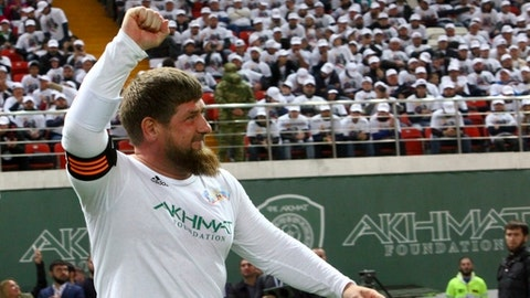 FILE - This is a Saturday, Oct. 7, 2017 file photo of Chechnya's regional leader Ramzan Kadyrov celebrates scoring against the Italian former players soccer team in Grozny, Russia. Egypt will be based at the World Cup in Chechnya with FIFA approving the facility despite the Russian regions leadership being criticized for widespread human rights violations and a crackdown on dissent. Egypt has selected a training facility in the Chechen capital Grozny for its first World Cup trip in 28 years. (AP Photo/Musa Sadulayev)
