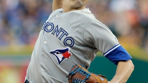 FILE - In this July 14, 2017, file photo, Toronto Blue Jays starting pitcher Aaron Sanchez throws during the first inning of a baseball game against the Detroit Tigers, in Detroit. Forget about Josh Donaldson's home run total, or Marcus Stroman's fastball velocity. The most important digit being measured at Blue Jays spring training is the middle finger on Aaron Sanchez's right hand. (AP Photo/Carlos Osorio, File)