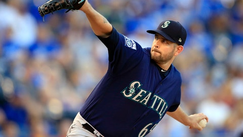 FILE - In this Aug. 4, 2017, file photo, Seattle Mariners starting pitcher James Paxton delivers to a Kansas City Royals batter during the first inning of a baseball game at Kauffman Stadium in Kansas City, Mo. The backend of Seattles starting rotation is the biggest question entering spring training. The Mariners are set at the top with James Paxton and Mike Leake.  (AP Photo/Orlin Wagner, File)