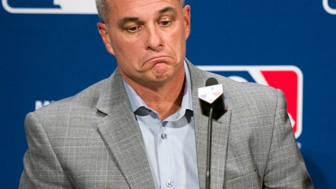 FILE - In this Dec. 7, 2016, file photo, Kansas City general manager Dayton Moore is shown during Major League Baseball's winter meetings in Oxon Hill, Md. The offseason Royals fans have been dreading for years has come and gone, and now a team that could bear little resemblance to its championship past is ready to report to spring training in Arizona. (AP Photo/Cliff Owen, File)