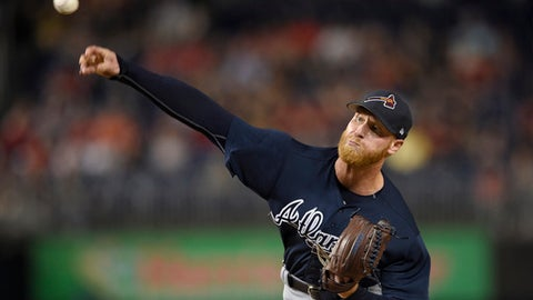 FILE - In this Sept. 14, 2017, file photo, Atlanta Braves starting pitcher Mike Foltynewicz delivers a pitch during the first inning of a baseball game against the Washington Nationals in Washington. Foltynewicz went to salary arbitration with the Atlanta Braves over a different of $100,000, the smallest gap among figures swapped by 27 players with their clubs in Jan. 2018. (AP Photo/Nick Wass, File)