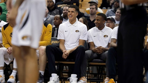 FILE - In this Dec. 5, 2017, file photo, Missouri's Michael Porter Jr. laughs on the bench during the second half of the team's NCAA college basketball game against Miami (Ohio) in Columbia, Mo. Porter is hopeful hell be cleared to return to practice from lower back surgery next week, providing a boost for a Tigers team aiming to reach the NCAA Tournament. The 6-foot-10 Porter, the top prep prospect in the country last season, played in only two minutes of the Tigers season-opening win over Iowa State before missing the rest of the season following surgery in November. (AP Photo/Jeff Roberson, File)