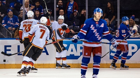 Calgary Flames' Matthew Tkachuk, third left, celebrates with teammates after scoring against New York Rangers during the first period of an NHL hockey game Friday, Feb. 9, 2018, at Madison Square Garden in New York. (AP Photo/Andres Kudacki)