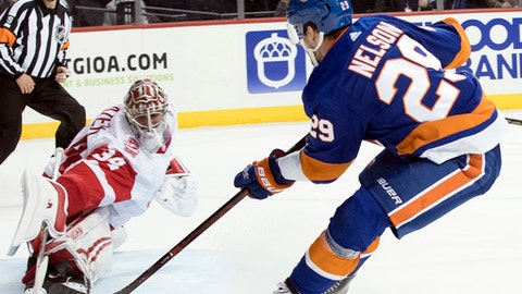 New York Islanders center Brock Nelson (29) scores the winning goal past Detroit Red Wings goaltender Petr Mrazek (34) during overtime of an NHL hockey game, Friday, Feb. 9, 2018, in New York. (AP Photo/Mary Altaffer)