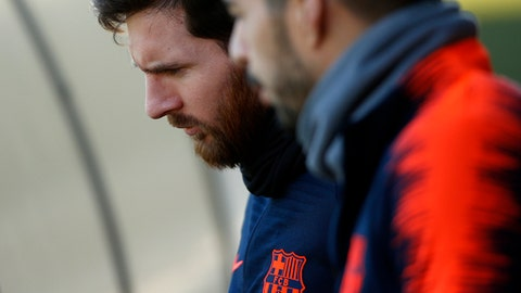 FC Barcelona's Luis Suarez, right, and Lionel Messi attend a training session at the Sports Center FC Barcelona Joan Gamper in Sant Joan Despi, Spain, Saturday, Feb. 10, 2018. FC Barcelona will play against Getafe in a Spanish La Liga soccer match on Sunday. (AP Photo/Manu Fernandez)