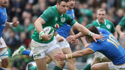 Ireland's Robbie Henshaw, left, gets away from Italy's Tommaso Allan during the Six Nations rugby union match between Ireland and Italy at the Aviva stadium in Dublin, Ireland, Saturday, Feb. 10, 2018 . (AP Photo/Peter Morrison)