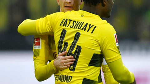 Dortmund's Michy Batshuayi celebrates with Dortmund's Marco Reus after scoring the opening goal during the German Bundesliga soccer match between Borussia Dortmund and Hamburger SV in Dortmund, Germany, Saturday, Feb. 10, 2018. (AP Photo/Martin Meissner)