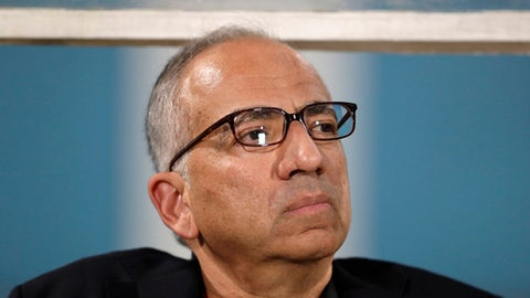 Carlos Cordeiro, vice president of U.S. soccer, watches warmups from the team bench ahead of the start of the U.S.'s final World Cup qualifying match against Trinidad and Tobago at Ato Boldon Stadium in Couva, Trinidad, Tuesday, Oct. 10, 2017. (AP Photo/Rebecca Blackwell)