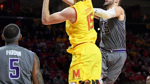 Northwestern forward Aaron Falzon (35) goes to the basket against Maryland center Michal Cekovsky (15) during the first half of an NCAA basketball game, Saturday, Feb. 10, 2018, in College Park, Md. Also seen is Northwestern center Dererk Pardon (5). (AP Photo/Nick Wass)