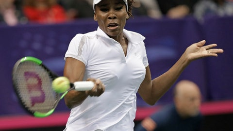 CORRECTS SPELLING OF FIRST NAME TO ARANTXA, NOT ARNATXA - USA's Venus Williams hits a return to Netherlands' Arantxa Rus during a match in the first round of Fed Cup tennis competition in Asheville, N.C., Saturday, Feb. 10, 2018. (AP Photo/Chuck Burton)