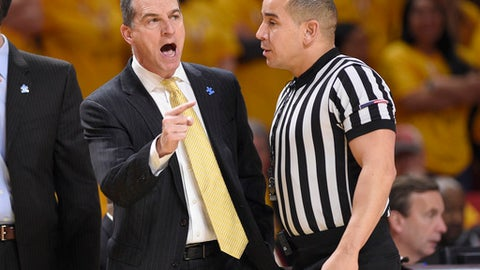 Maryland head coach Mark Turgeon, left, gestures next to an official during the first half of an NCAA basketball game against Northwestern, Saturday, Feb. 10, 2018, in College Park, Md. (AP Photo/Nick Wass)