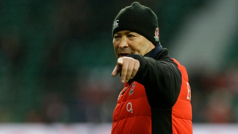 England's head coach Eddie Jones gestures during the warm up prior to the start of the Six Nations international rugby union match at Twickenham stadium in London, Saturday, Feb. 10, 2018. (AP Photo/Alastair Grant)