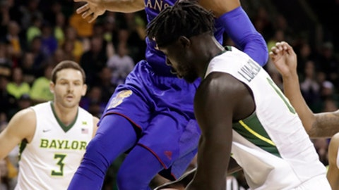 Baylor forward Jo Lual-Acuil Jr. (0) of Australia strips the ball away from Kansas guard Devonte' Graham (4) beneath the basket in the first half of an NCAA college basketball game Saturday, Feb. 10, 2018, in Waco, Texas. (AP Photo/Tony Gutierrez)