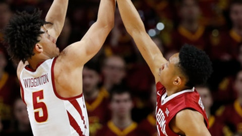 Iowa State guard Lindell Wigginton (5) is fouled by Oklahoma guard Jordan Shepherd, right, during the first half of an NCAA college basketball game, Saturday, Feb. 10, 2018, in Ames, Iowa. (AP Photo/Charlie Neibergall)