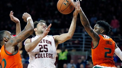 Miami's Chris Lykes (2) blocks a shot by Boston College's Jordan Chatman (25) during the first half of an NCAA college basketball game in Boston, Saturday, Feb. 10, 2018. (AP Photo/Michael Dwyer)