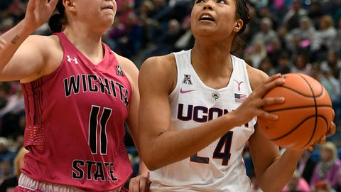 Connecticut's Napheesa Collier, right, looks to shoot as Wichita State's Sabrina Lozada-Cabbage, left, defends during the first half of an NCAA college basketball game, Saturday, Feb. 10, 2018, in Hartford, Conn. (AP Photo/Jessica Hill)