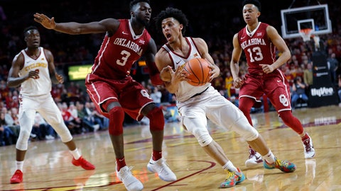 Iowa State guard Lindell Wigginton drives past Oklahoma forward Khadeem Lattin (3) during the second half of an NCAA college basketball game, Saturday, Feb. 10, 2018, in Ames, Iowa. (AP Photo/Charlie Neibergall)