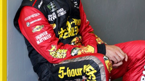 Martin Truex Jr. takes a break in his garage while his crew makes adjustments to his car during a NASCAR auto racing practice session at Daytona International Speedway, Saturday, Feb. 10, 2018, in Daytona Beach, Fla. (AP Photo/Terry Renna)