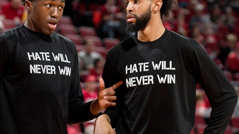 center Jordy Tshimanga (32) and forward Isaac Copeland (14) talk before an NCAA college basketball game against Rutgers, Saturday, Feb. 10, 2018, at Pinnacle Bank Arena. The shirts they're wearing were part of the response planned by the Huskers to white nationalist videos that emerged earlier this week featuring Nebraska student Daniel Kleve. (Frances Gardler/The Journal-Star via AP)