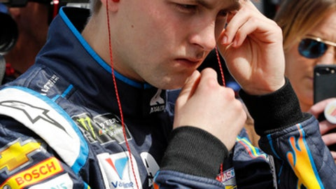 William Byron adjusts his ear plugs before getting in his car during  NASCAR auto racing practice at Daytona International Speedway, Saturday, Feb. 10, 2018, in Daytona Beach, Fla. (AP Photo/Terry Renna)