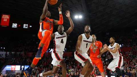 Auburn's Jared Harper (1) shoots against Georgia's Tyree Crump (4) and Yante Maten (1) in the first half of an NCAA college basketball game, Saturday, Feb. 10, 2018, in Athens, Ga. (AP Photo/John Bazemore)