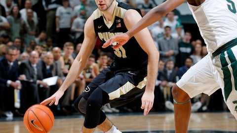 Purdue's Dakota Mathias, left, drives against Michigan State's Cassius Winston during the first half of an NCAA college basketball game, Saturday, Feb. 10, 2018, in East Lansing, Mich. (AP Photo/Al Goldis)