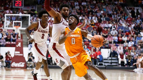 Tennessee guard Jordan Bone drives the ball to the basket against Alabama forward Braxton Key and guard Collin Sexton during the first half of an NCAA college basketball game Saturday, Feb. 10, 2018, in Tuscaloosa, Ala. (AP Photo/Brynn Anderson)