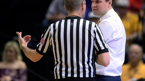 LSU coach Will Wade speaks to a game official during the first half against Mississippi an NCAA college basketball game Saturday, Feb. 10, 2018, in Baton Rouge, La. (Hilary Scheinuk/The Advocate via AP)