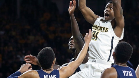 Wichita State forward Darral Willis Jr. fights for a rebound against Connecticut guard Jalen Adams during the first half of an NCAA college basketball game Saturday, Feb. 10, 2018, in Wichita, Kan. (Travis Heying/The Wichita Eagle via AP)