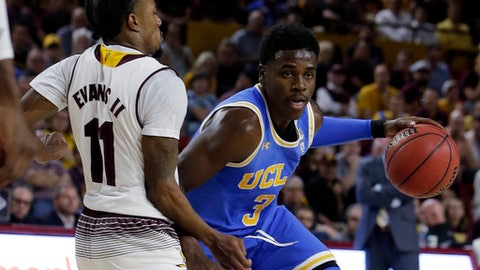 UCLA guard Aaron Holiday (3) drives on Arizona State guard Shannon Evans II in the first half during an NCAA college basketball game, Saturday, Feb. 10, 2018, in Tempe, Ariz. (AP Photo/Rick Scuteri)