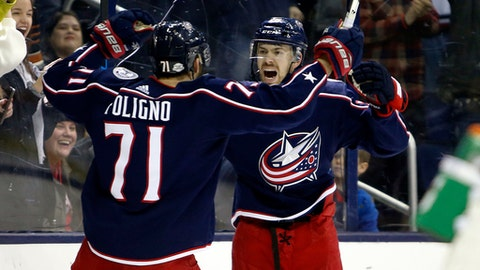 Columbus Blue Jackets' Oliver Bjorkstrand, right, of Denmark, celebrates his goal against the New Jersey Devils with teammate Nick Foligno during the second period of an NHL hockey game, Saturday, Feb. 10, 2018, in Columbus, Ohio. (AP Photo/Jay LaPrete)
