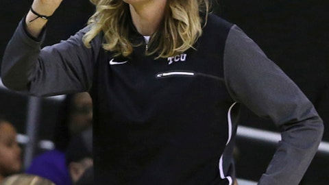 TCU coach Raegan Pebley calls a play for her team during the first half against Baylor in an NCAA college basketball game Saturday, Feb. 10, 2018, in Waco, Texas. (AP Photo/Jerry Larson)