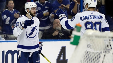 Tampa Bay Lightning right wing Nikita Kucherov (86) celebrates his goal against the Los Angeles Kings with center Vladislav Namestnikov (90) during the second period of an NHL hockey game Saturday, Feb. 10, 2018, in Tampa, Fla. (AP Photo/Chris O'Meara)