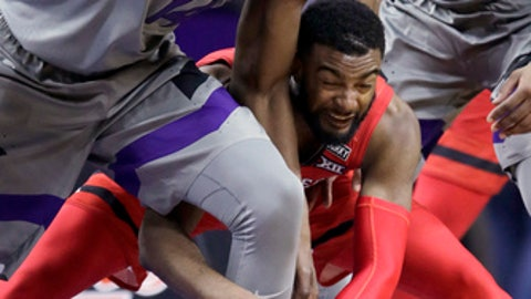 Kansas State forward Makol Mawien (14) grabs a loose ball before Texas Tech guard Niem Stevenson, bottom, can get to it during the second half of an NCAA college basketball game in Manhattan, Kan., Saturday, Feb. 10, 2018. Texas Tech defeated Kansas State 66-47. (AP Photo/Orlin Wagner)