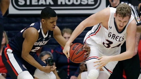 Gonzaga guard Zach Norvell Jr., left, strips the ball from Saint Mary's center Jock Landale during the first half of an NCAA college basketball game Saturday, Feb. 10, 2018, in Moraga, Calif. (AP Photo/Marcio Jose Sanchez)
