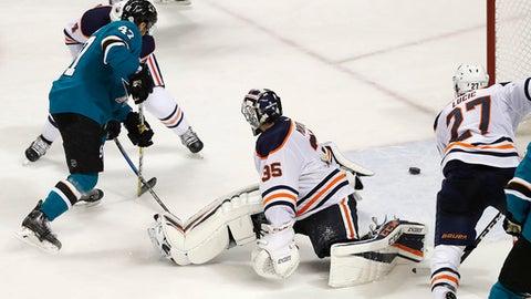 San Jose Sharks defenseman Joakim Ryan (47) scores a goal past Edmonton Oilers goaltender Al Montoya (35) during the third period of an NHL hockey game Saturday, Feb. 10, 2018, in San Jose, Calif. San Jose won 6-4. (AP Photo/Tony Avelar)