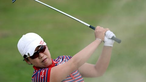 South Korea's Jiyai Shin plays a shot from the bunker on 9th green, during the third day of the Women's British Open golf championship, at the Royal Birkdale Golf Club, in Southport, England, Saturday, July 12, 2014. (AP Photo/Scott Heppell)