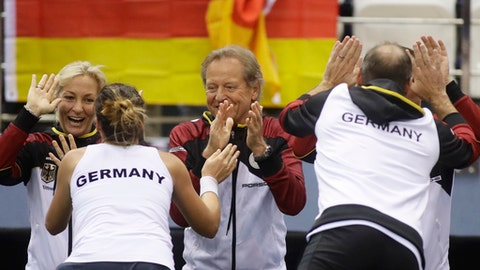 Tatjana Maria of Germany and team captain Jens Gerlach celebrates with teammates their victory during the Fed Cup World Group first round tennis match against Vera Lapko of Belarus in Minsk, Belarus, Sunday, Feb. 11, 2018. (AP Photo/Sergei Grits)