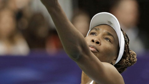 USA's Venus Williams prepares to serve to Netherlands' Richel Hogenkamp during a match in the first round of Fed Cup tennis competition in Asheville, N.C., Sunday, Feb. 11, 2018. (AP Photo/Chuck Burton)