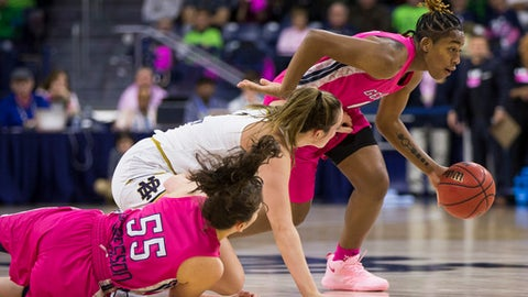 Georgia Tech's Kaylan Pugh, right, turns downcourt after grabbing the ball next to teammate Antonia Peresson (55) and Notre Dame's Marina Mabrey during the first half of an NCAA college basketball game Sunday, Feb. 11, 2018, in South Bend, Ind. (AP Photo/Robert Franklin)