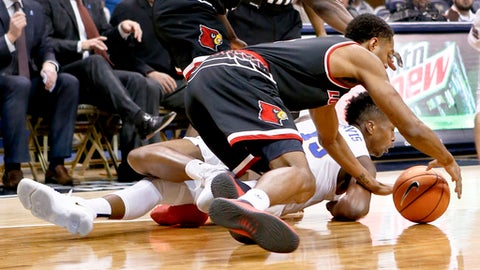 Louisville's V.J. King, top, and Pittsburgh's Kene Chukwuka (15) scramble for the ball during the first half of an NCAA college basketball game, Sunday, Feb. 11, 2018, in Pittsburgh. (AP Photo/Keith Srakocic)