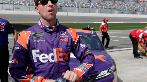 Denny Hamlin looks up at the leaderboard after his qualifying run for the NASCAR Daytona 500 auto race at Daytona International Speedway, Sunday, Feb. 11, 2018, in Daytona Beach, Fla. (AP Photo/John Raoux)