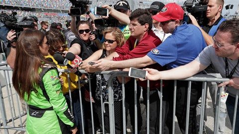 Danica Patrick, front left, talks with members of the media during qualifying for the NASCAR Daytona 500 auto race at Daytona International Speedway, Sunday, Feb. 11, 2018, in Daytona Beach, Fla. (AP Photo/John Raoux)
