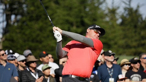 Ted Potter Jr. follows his shot from the fourth tee of the Pebble Beach Golf Links during the final round of the AT&T Pebble Beach National Pro-Am golf tournament Sunday, Feb. 11, 2018, in Pebble Beach, Calif. (AP Photo/Eric Risberg)