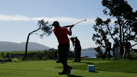 Ted Potter Jr. follows his shot from the fifth tee of the Pebble Beach Golf Links during the final round of the AT&T Pebble Beach National Pro-Am golf tournament Sunday, Feb. 11, 2018, in Pebble Beach, Calif. (AP Photo/Eric Risberg)