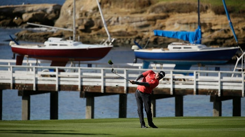 Ted Potter Jr. hits from the fourth fairway of the Pebble Beach Golf Links during the final round of the AT&T Pebble Beach National Pro-Am golf tournament Sunday, Feb. 11, 2018, in Pebble Beach, Calif. (AP Photo/Eric Risberg)